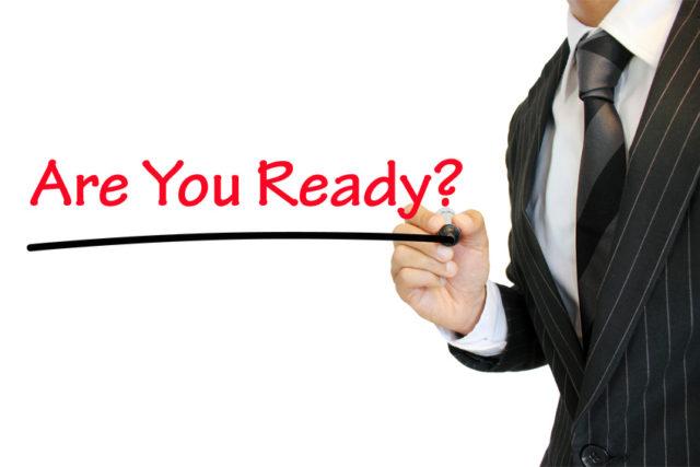 スーツの男性が「Are You Ready?」と書いている画像