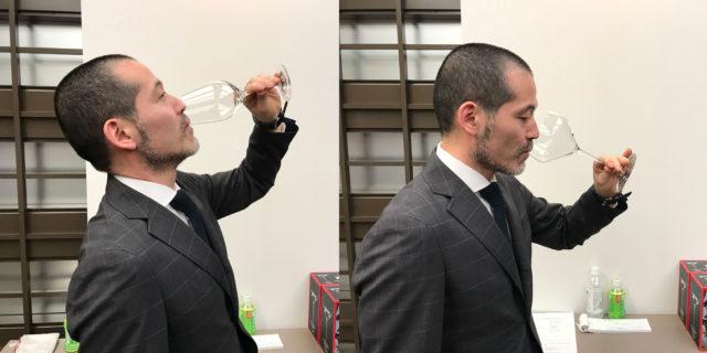 ワイングラスで日本酒を飲む男性