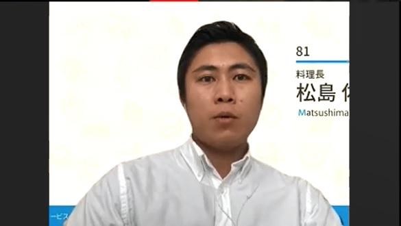 少し険しい顔の松島さんの写真